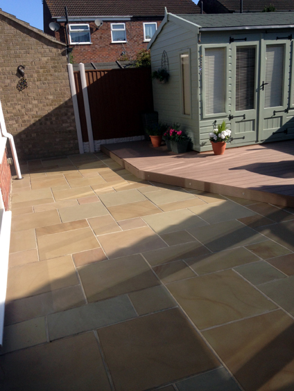 This patio constructed with high quality sandstone paving