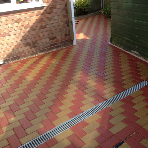 Red and buff patio sealed with Resiblock